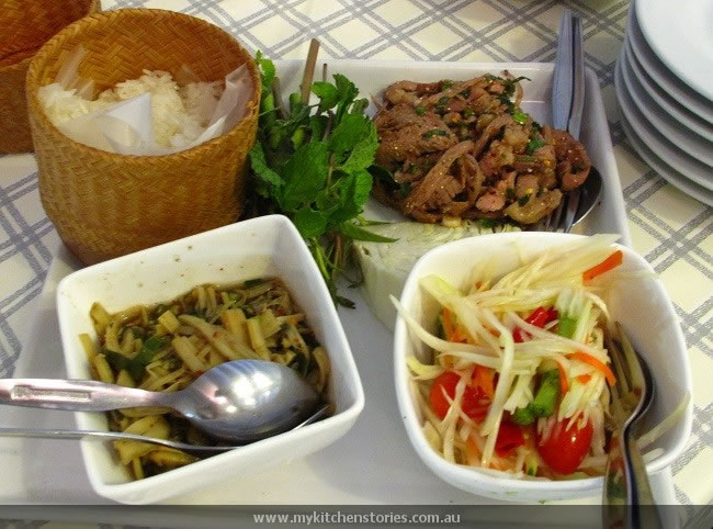 Pork, catfish salad, green papaya salad and bamboo salad