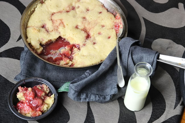 Warm Strawberry Balsamic Sponge in a frypan with cream