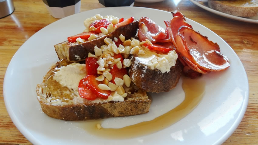 French toast, ricotta, macadamias ans strawberries with a side of bacon $15