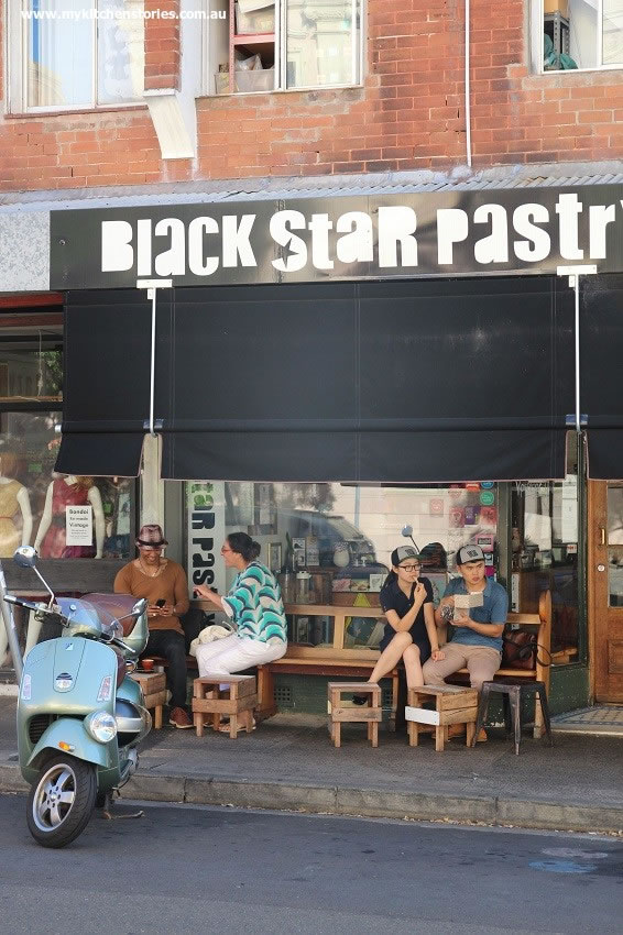 Black Star. Photo taken after 5 when the shop is shut. Still people there!
