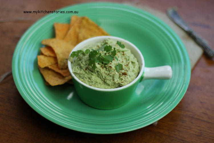 Guacamole without avocado in a bowl with chips