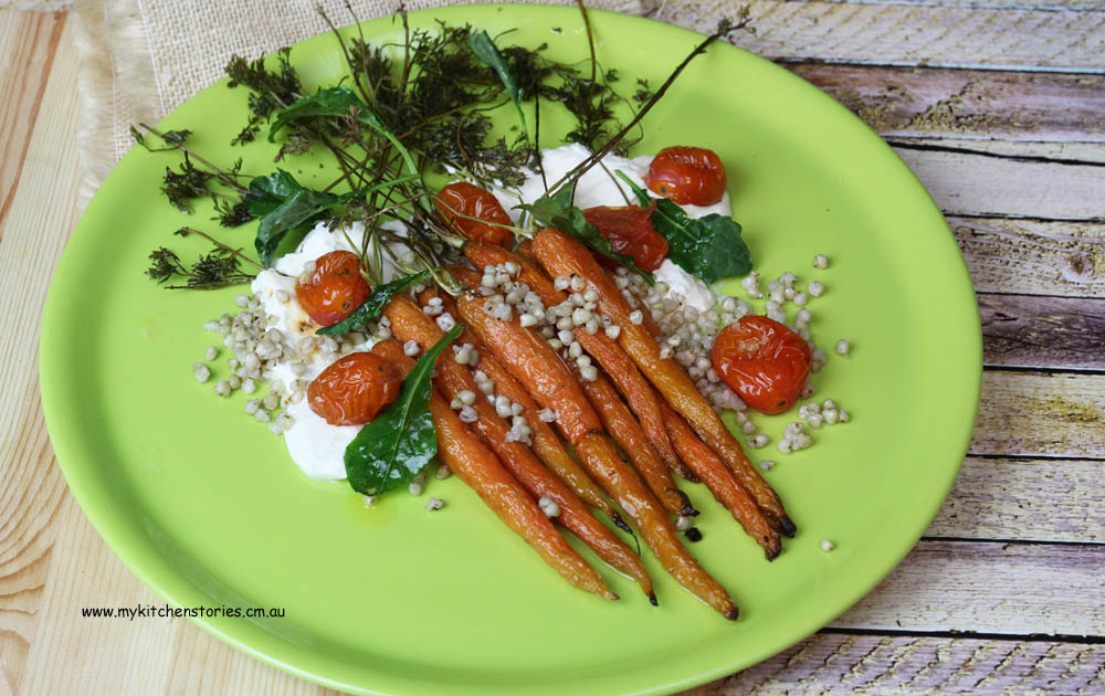 Carrot, goat cheese and baby kale buckwheat, tomato