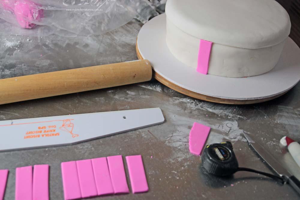 Pink bow cake making a box