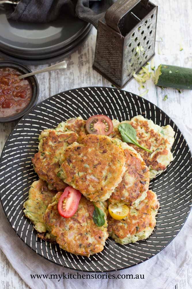 Ham Zucchini Ricotta Fritters on a black plate