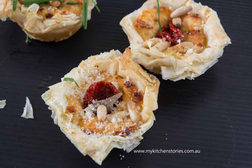 easy Ricotta Mini Pies on a black platter