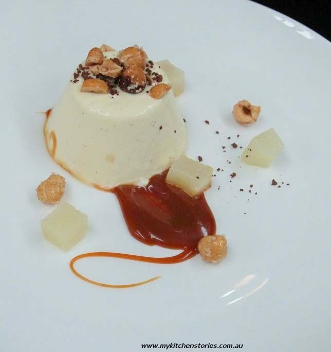 A creamy mascarpone panna cotta on a plate with salted caramel