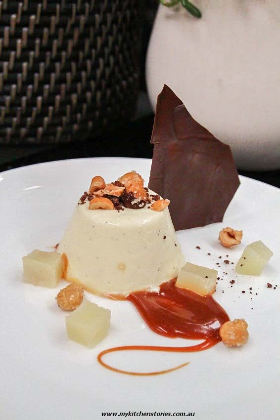 Mascarpone Panna cotta on a plate with pears and caramel