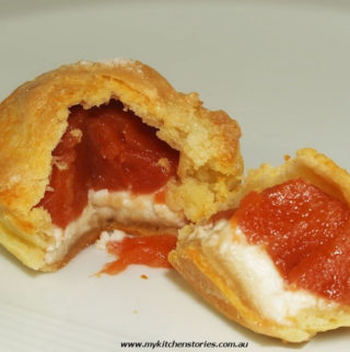 Goat Curd, Quince, Marzipan Pies cut in half