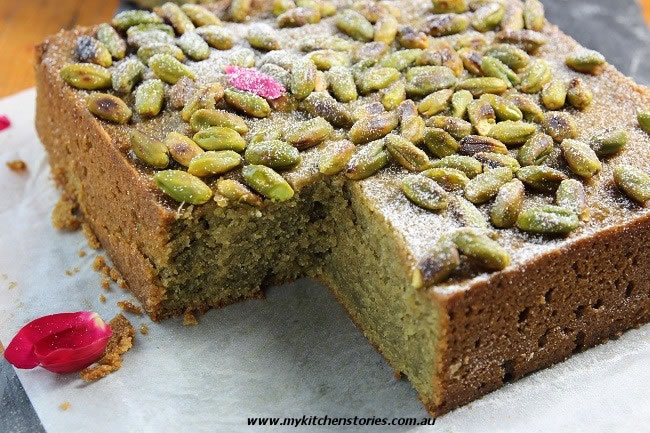 Pistachio Lemon Syrup Cake with nuts on top