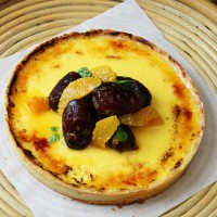 Custard Tart with citrus and dates on a platter