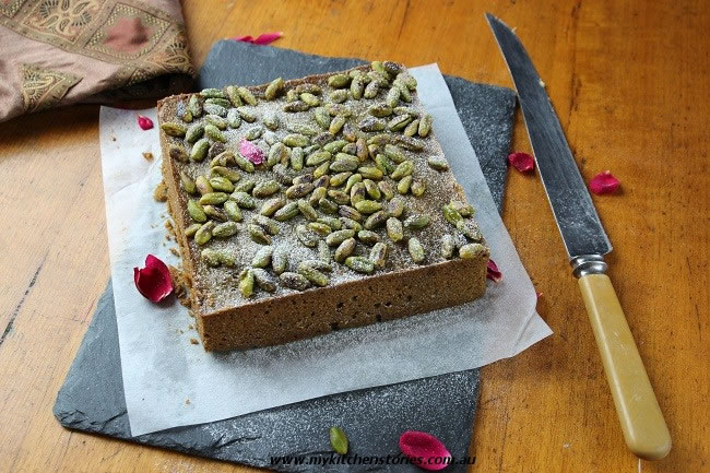 Pistachio Lemon Syrup Cake ready to be sliced