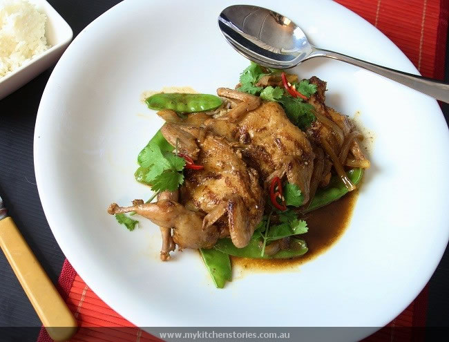 Coca Cola Quail on a plate with snowpeas