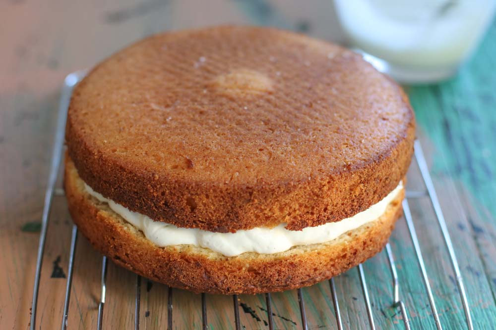 Ricotta and lemon cake with whipped ricotta on a rack