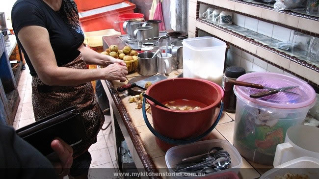 Making the fresh juice. they are kept in acidated water to stop discolouring