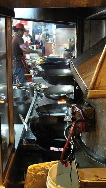Kitchen. The line of woks