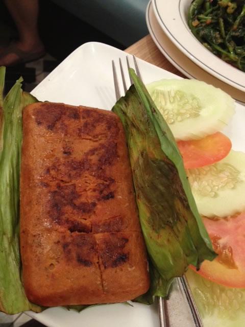 Otek otek. Fish paste and egg , cooked in Banana leaf