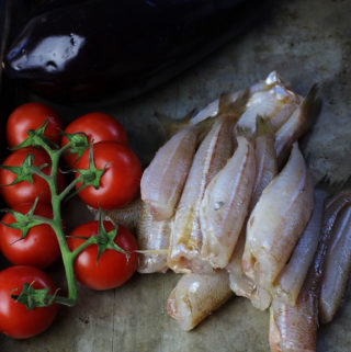 Fried whiting and roast tomatoes