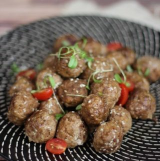 Beef and feta meatballs on a black plate