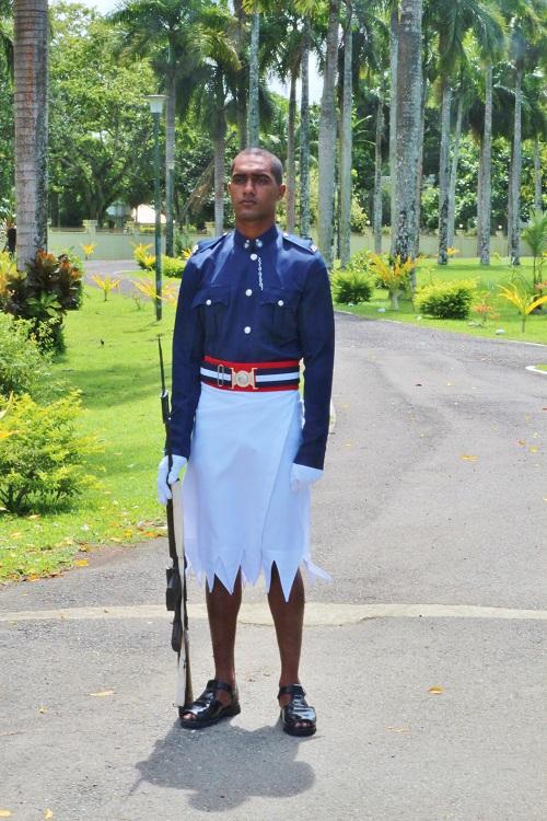 A Fijian policeman in uniform outside parliament