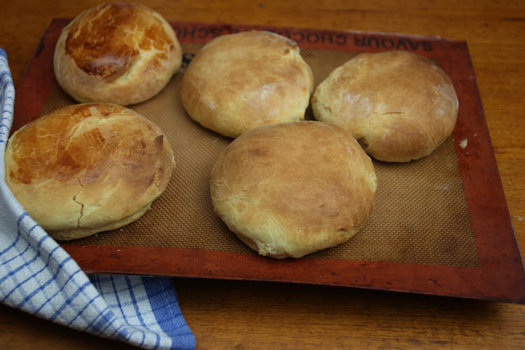 No Knead Brioche Bread rolls on a tray