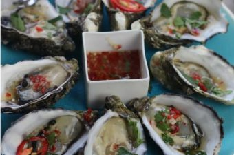 Oysters Spicy Maple dressing , oysters on the 1/2 shell