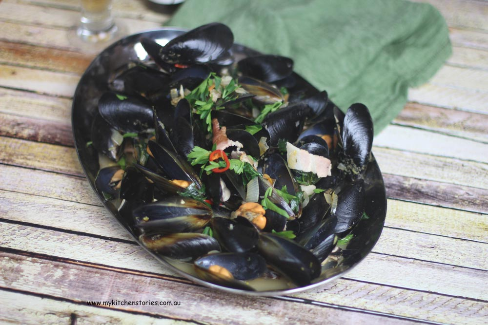Beer steamed mussels on a platter
