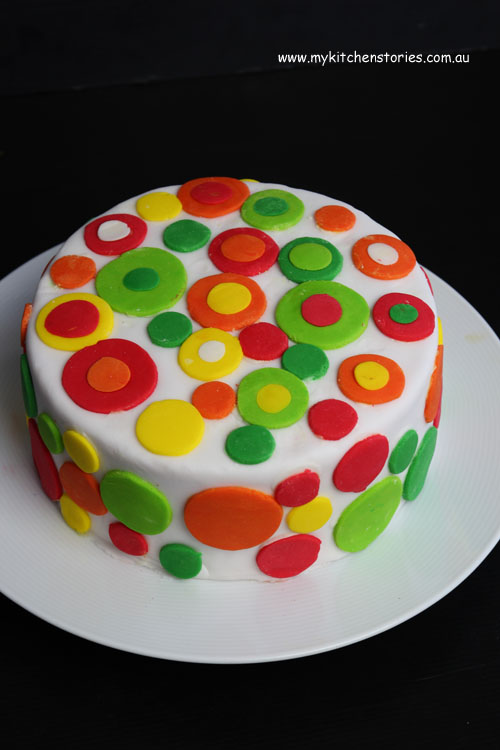 Rainbow cake in red green and orange