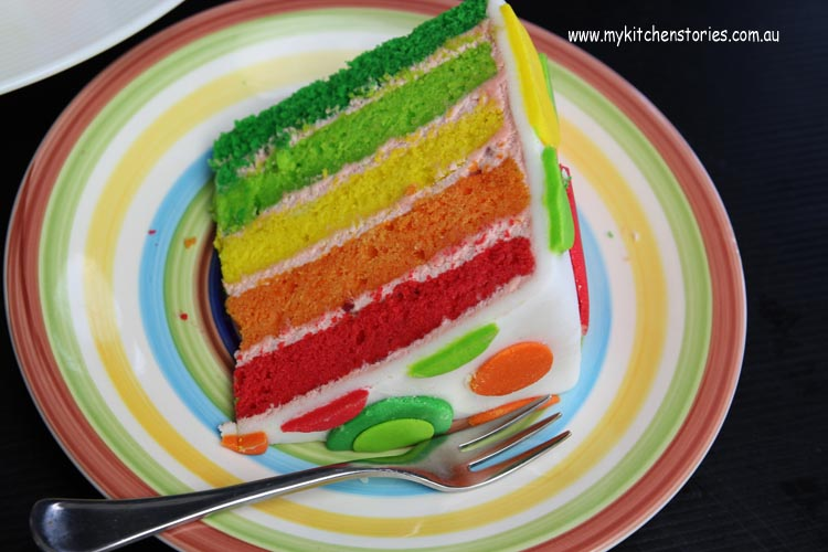 Rainbow Cake on a stripy plate