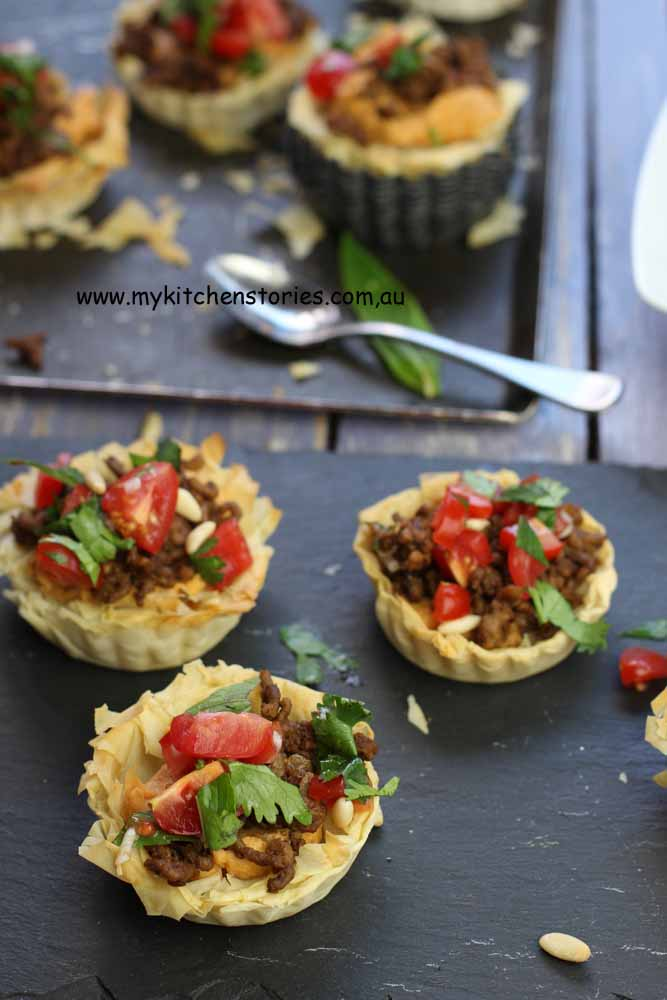 Lamb and Hommus Tarts with tomato salad