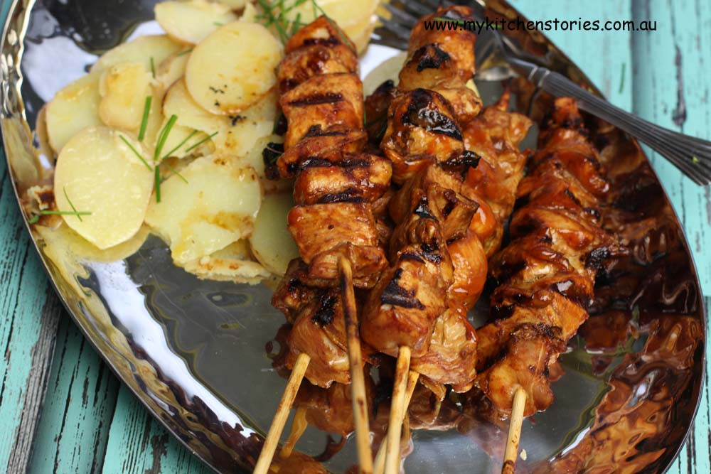Chicken kebabs on the BBQ with potatoes