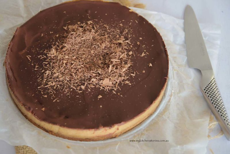 A gluten free date and chocolate tart uncut