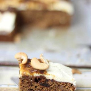 date tray cake, with icing and cashews