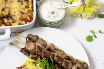 Weeknight Lamb skewers , zucchini cheese bake