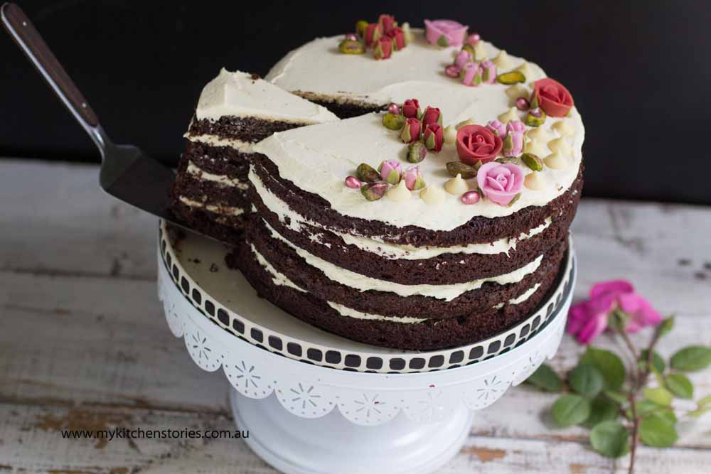 Chocolate zucchini layer cake on a white stand