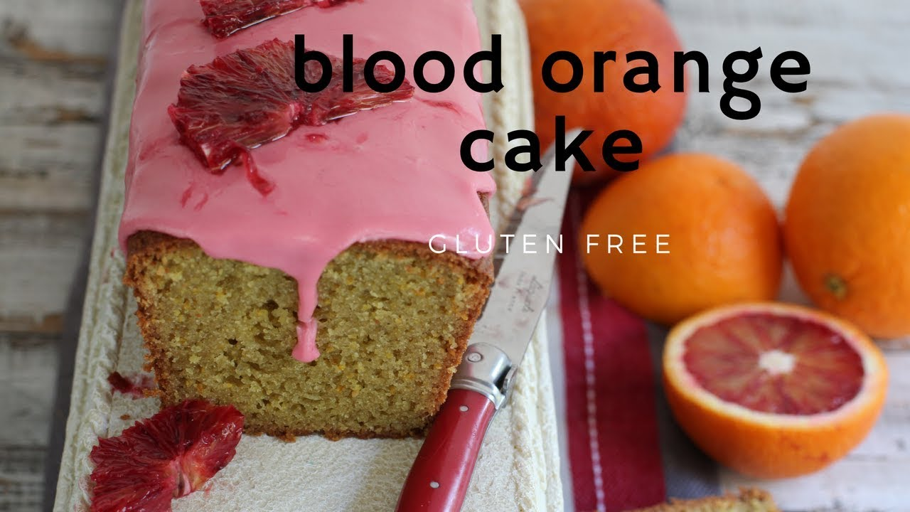 A loaf cake made with bllod oranges and pink icing