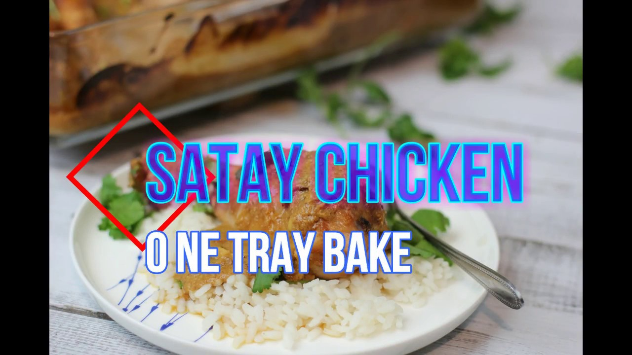satay chicken baked in one tray with a bowl and chicken and rice in front