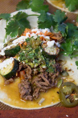 Jalapeno, lime, coriander dressing on tacos