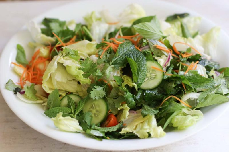 Vietnamese salad with cucumber and pickled carrot on a white platter