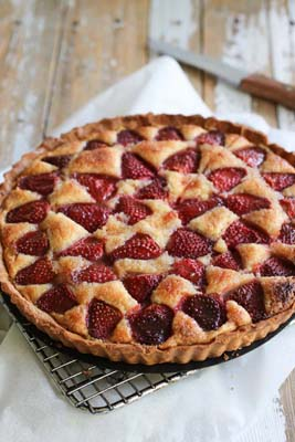 Freshly baked strawberry tart on a rack