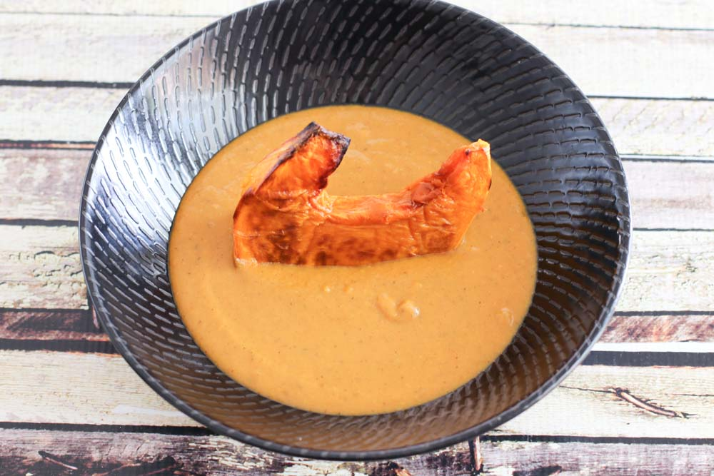 Pumpkin Soup with a piece of roasted pumpkin in it