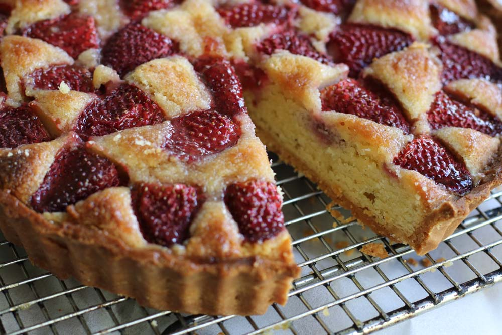Fine shortbread pastry under a frangipane tart
