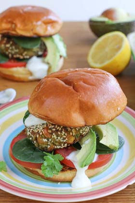 Falafel pattie burger on a stripy plate