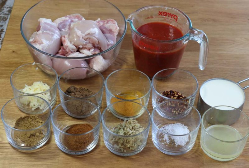 ingredients layed out on the table to make butter chicken