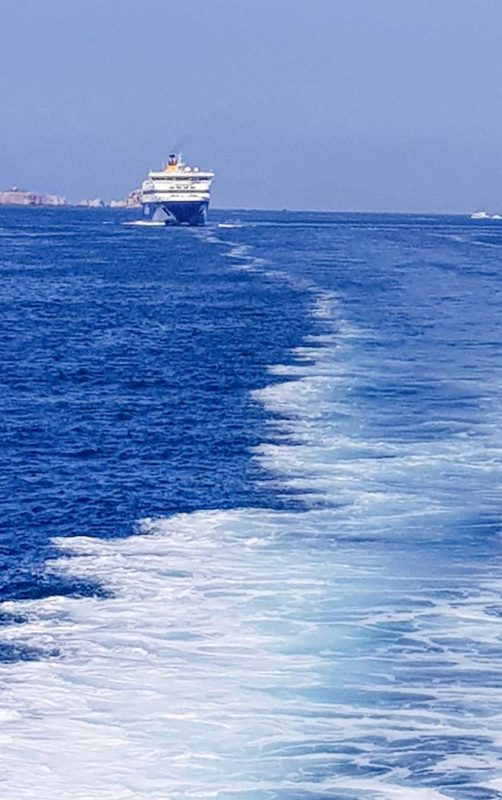 A ferry leaving Athens in Greece
