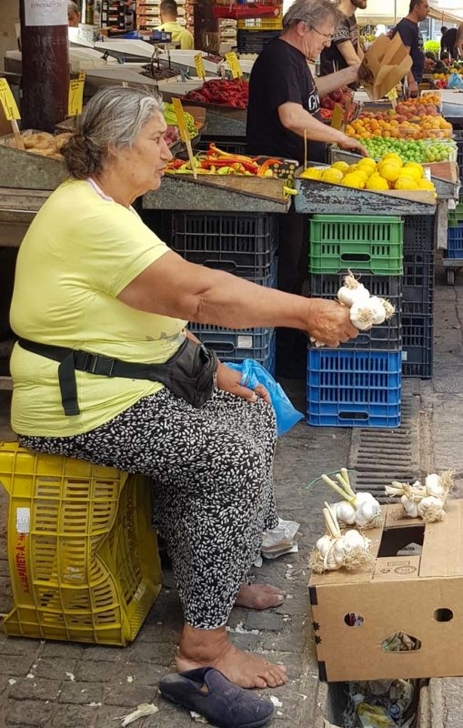 A garlic seller on the streets in Athens