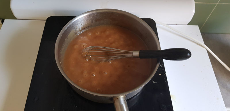 Miso suace boiling in the pot on a stove