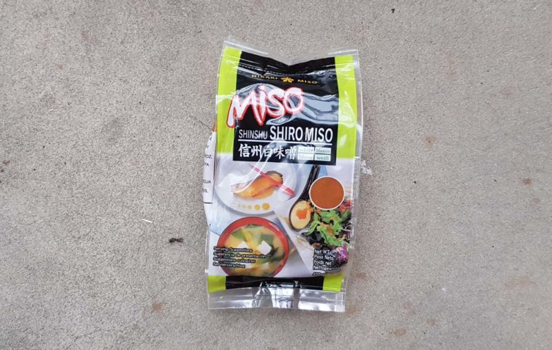 A packet of white miso showing the label