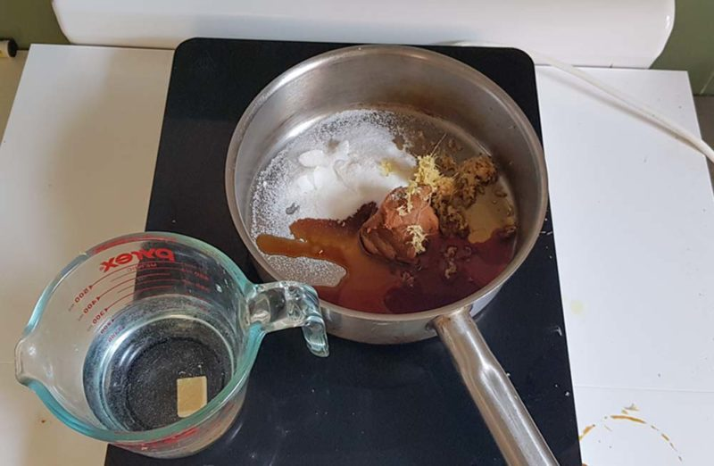 Making miso sauce in a saucepan with stock and sugar