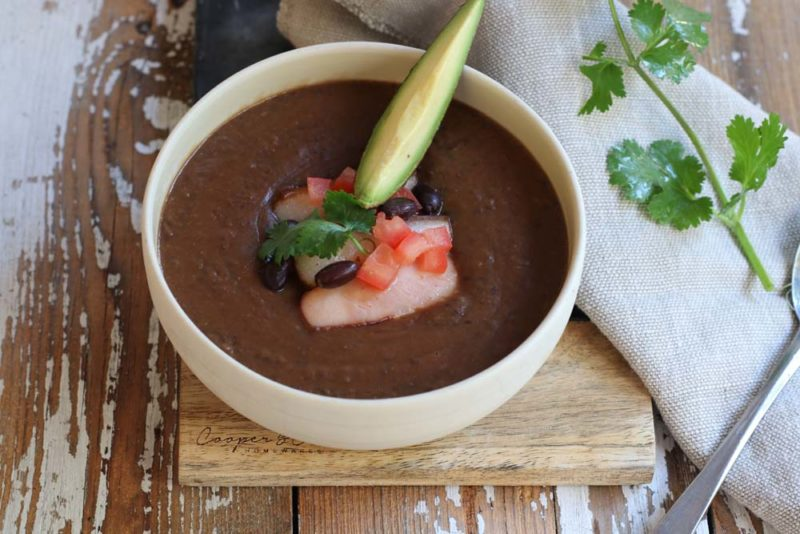 A white bowl with thick blackbean soup