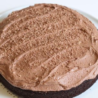 Chocolate Sourdogh cake with buttercream on a white plate